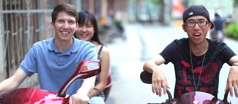 three people riding mopeds in China