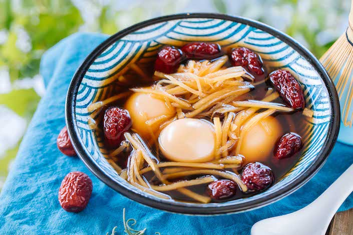 bowl of chinese hard boiled eggs in sweet broth