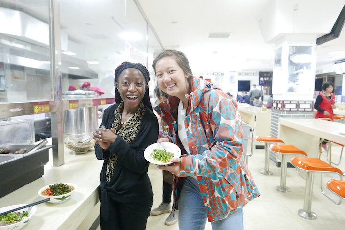 two young women at a cafeteria in china